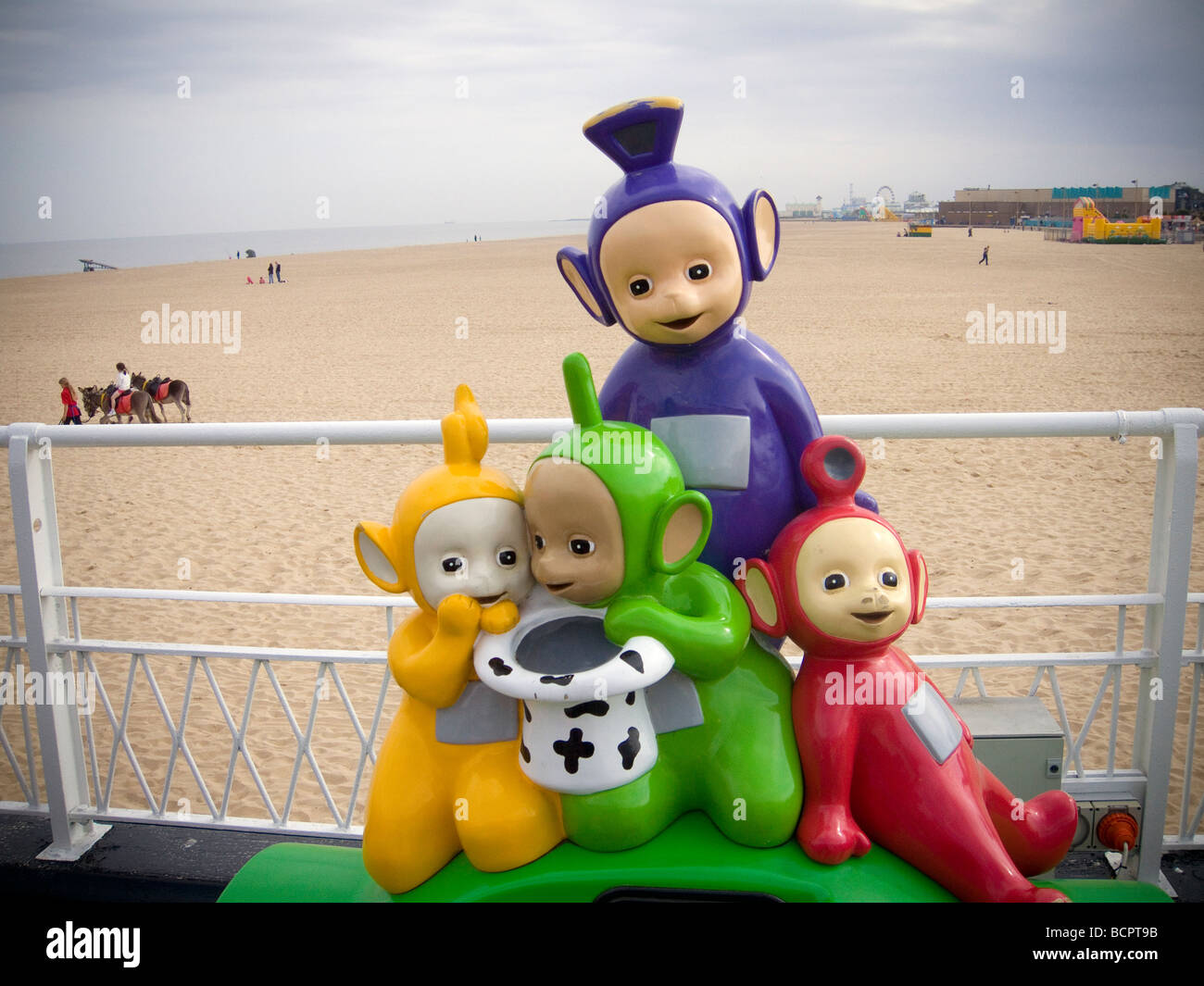 Tele-Tubbies amusement machine at the sea-side. Great Yarmouth Pier. UK - Stock Image