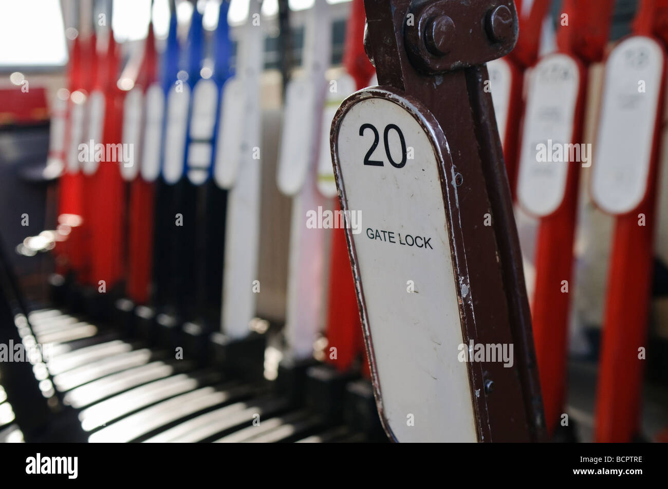 Levers on a lever frame in a manually operated signal box to operate points and signals - Stock Image