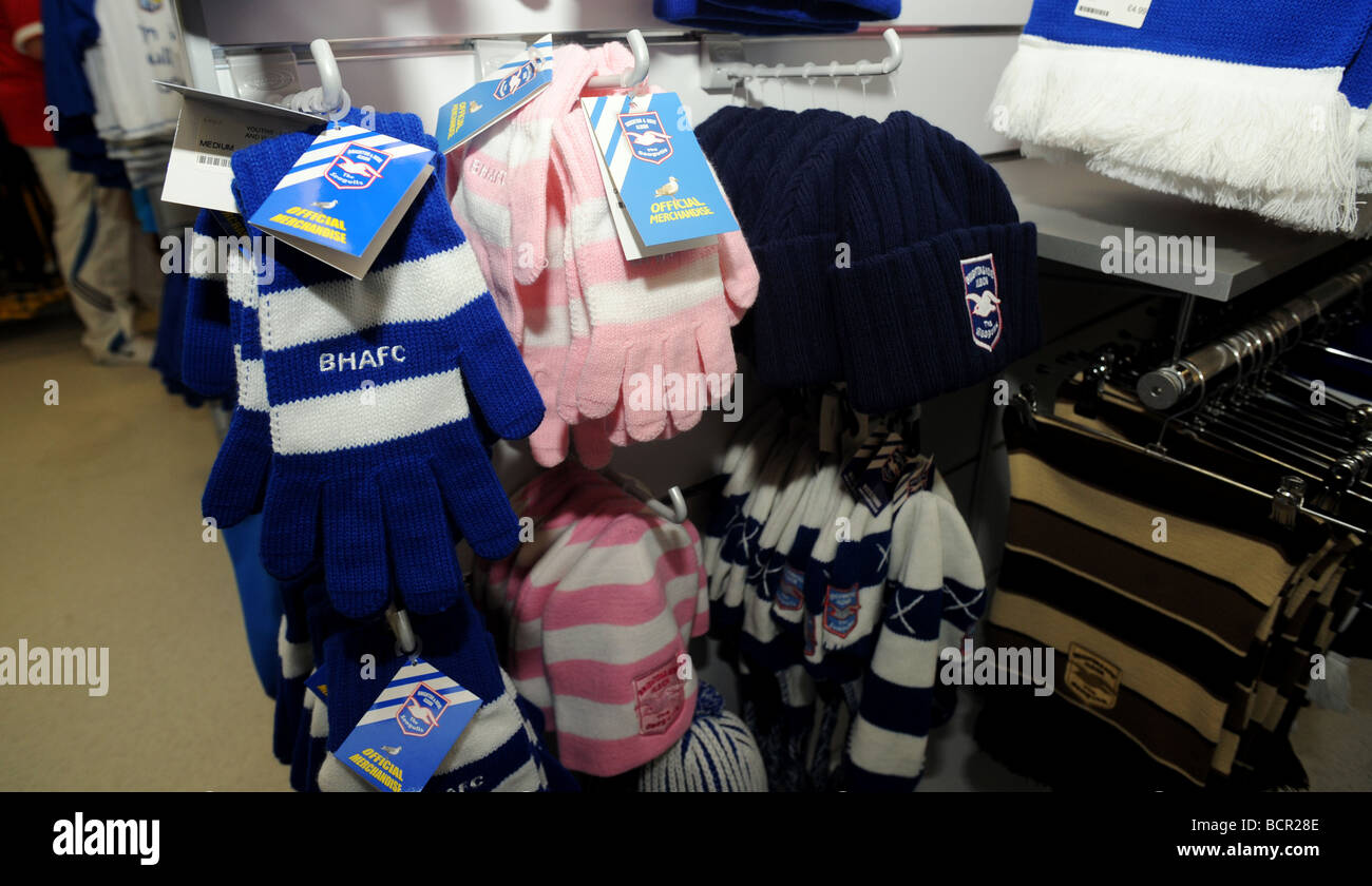 Football memorabilia on sale in the brighton and hove albion shop - Stock Image
