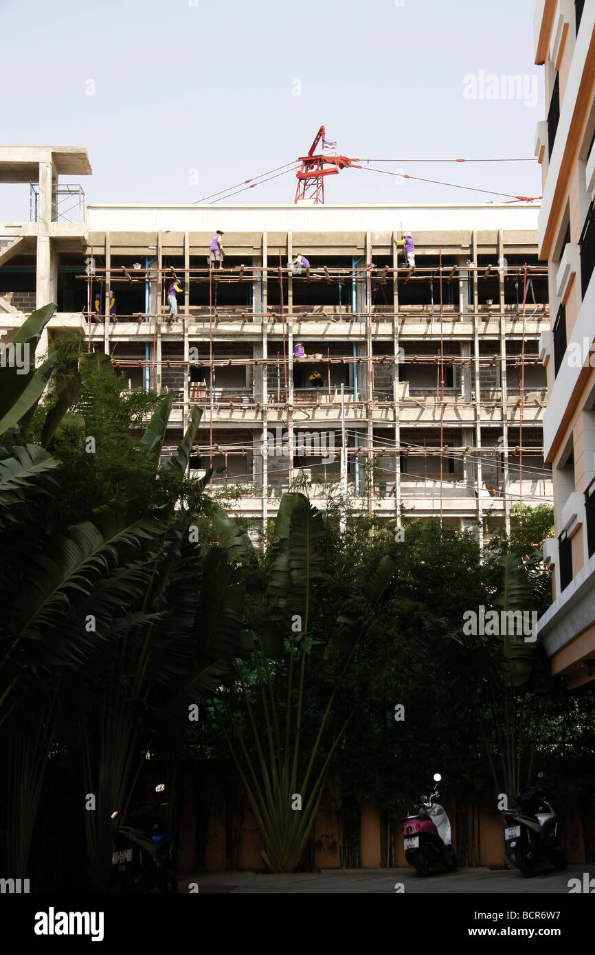 Hotel construction work in Thailand - Stock Image