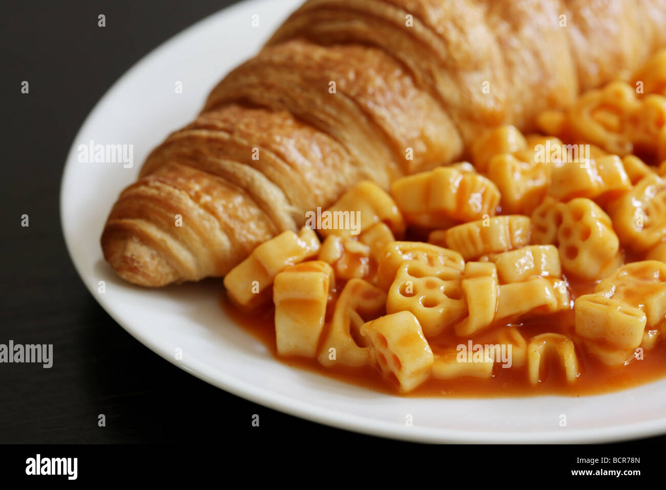 Croissant with Pasta Shapes - Stock Image