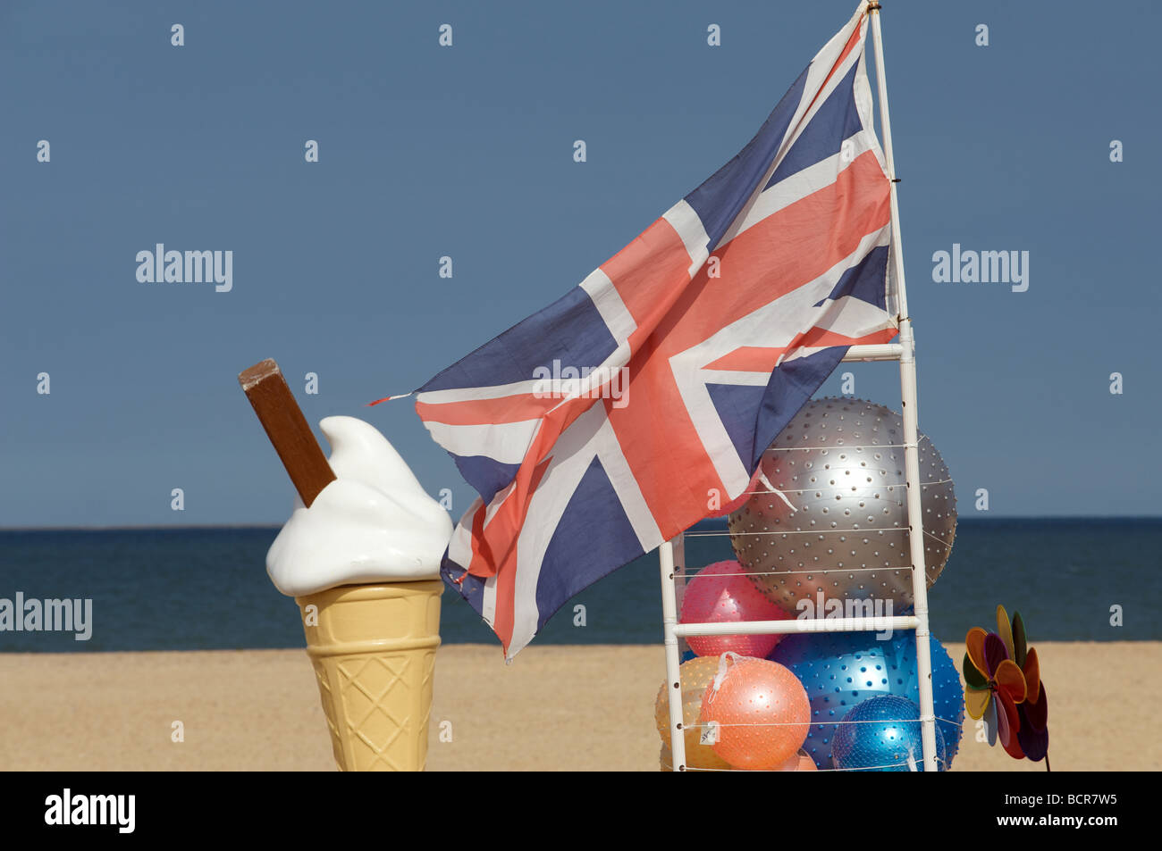 Stall selling ice creams and beach balls, Great Yarmouth, Norfolk, UK. - Stock Image