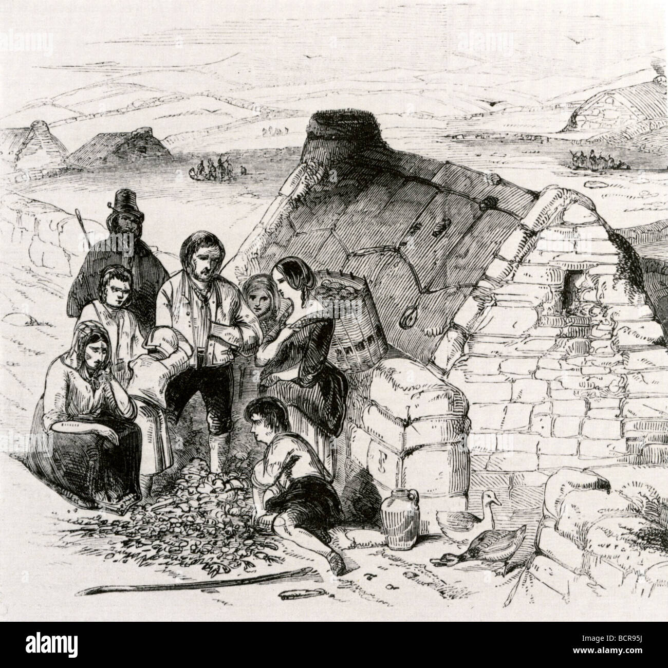 IRISH POTATO FAMINE 1845 - 1849 - a starving Irish family outside their  turf-roofed cottage