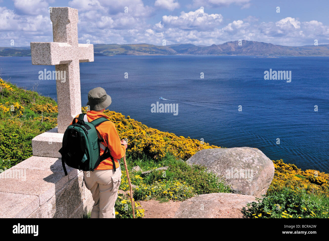 Spain, St. James Way: End of the world – St. James Pilgrim at the Cabo Fisterra in Galicia - Stock Image