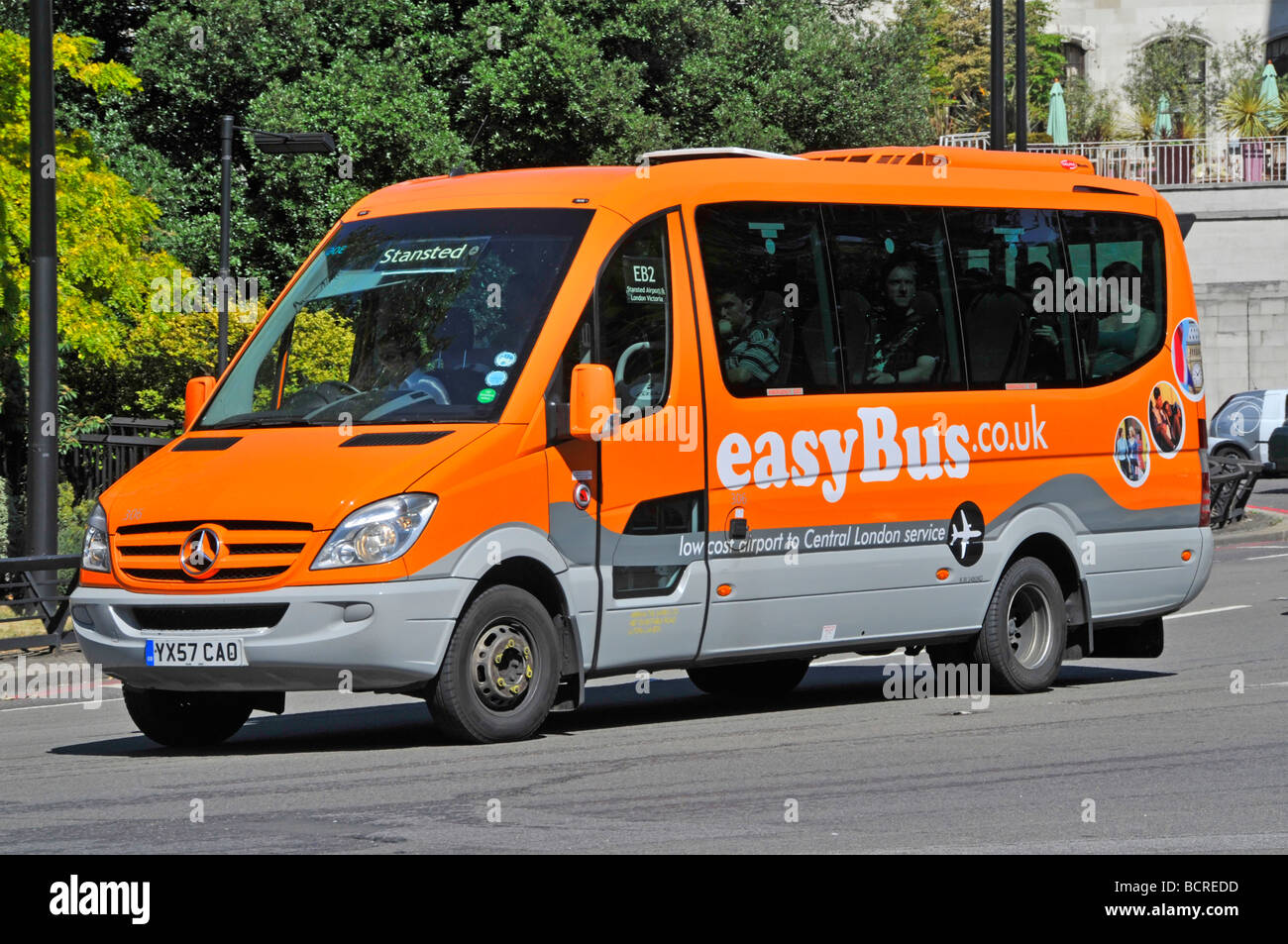 EastBus low cost mini bus service between Central London and Stansted Airport operated by Arriva - Stock Image