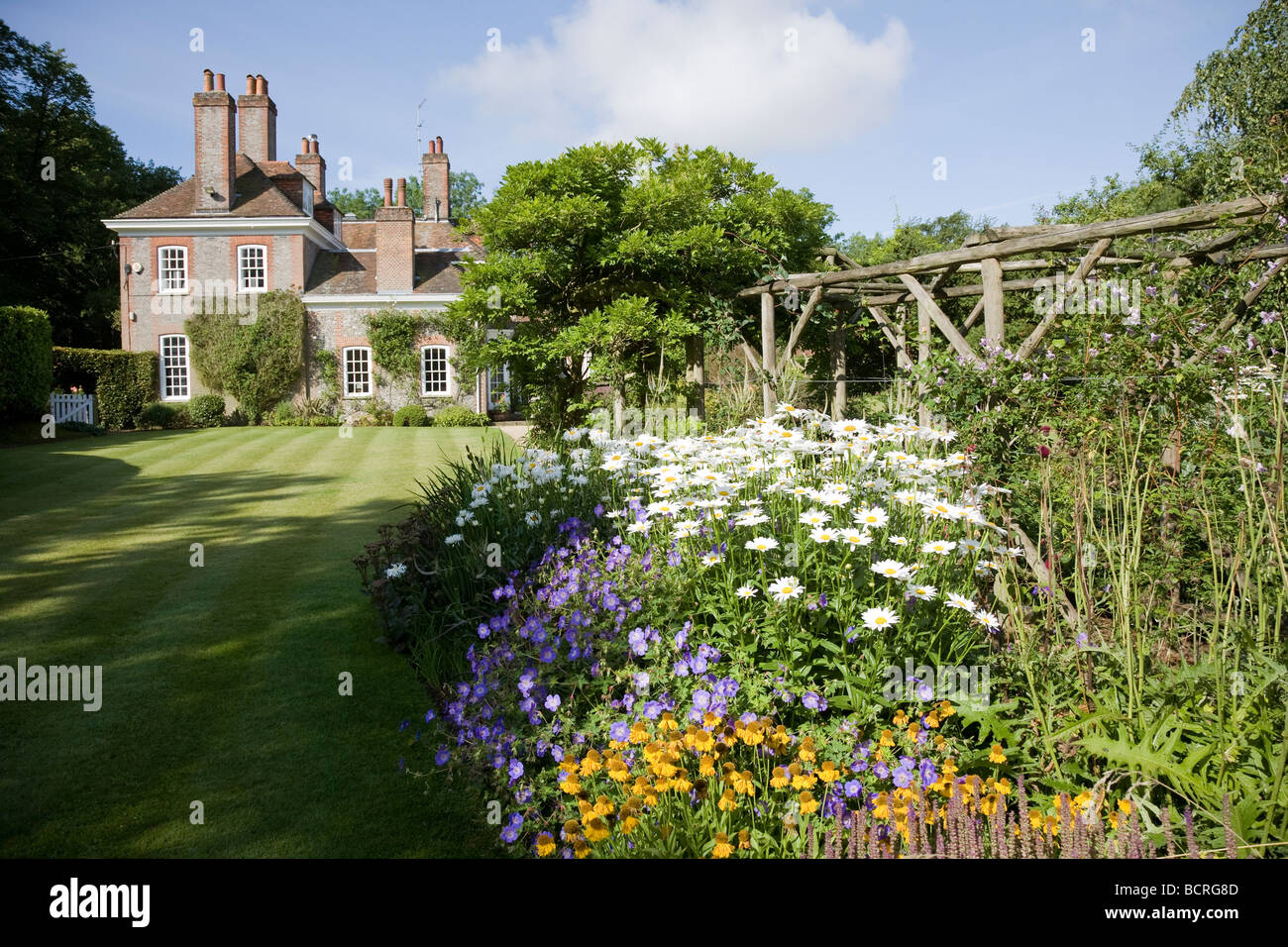 Herbaceous border in country house garden in Berkshire. - Stock Image