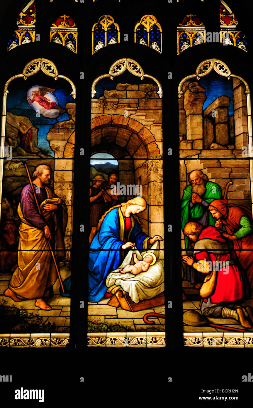 Stained Glass Window depicting the nativity in Peterhouse College Chapel, Cambrridge England UK - Stock Image