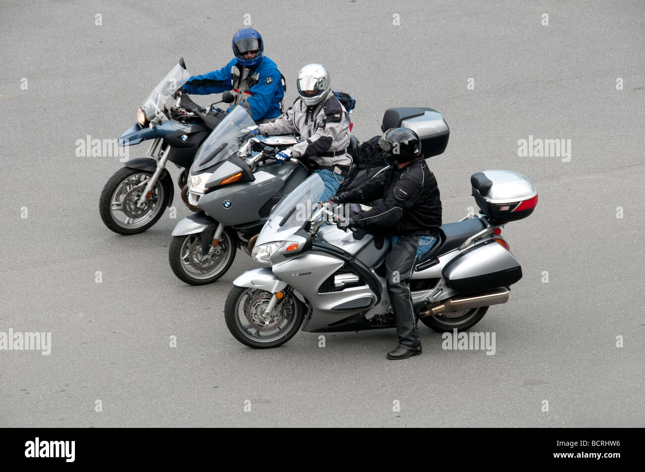 Three bikers. - Stock Image