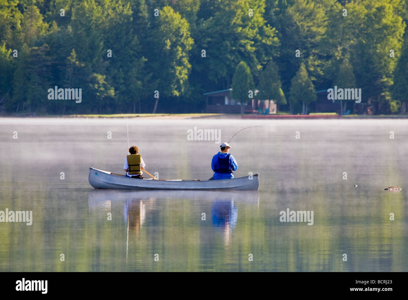 Couple fishing from canoe in Fourth Lake near Inlet in the