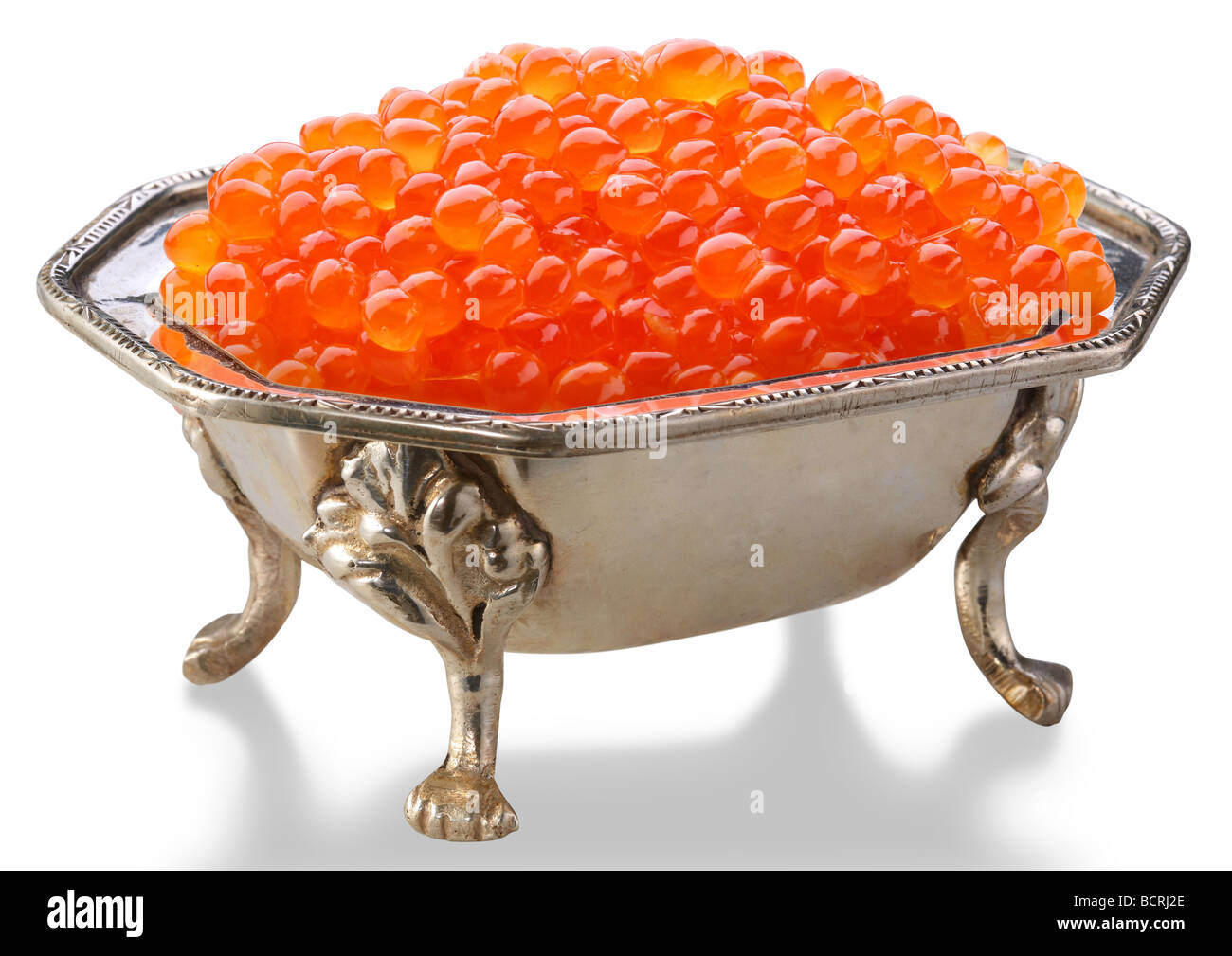Red caviar is in a silver bowl - Stock Image