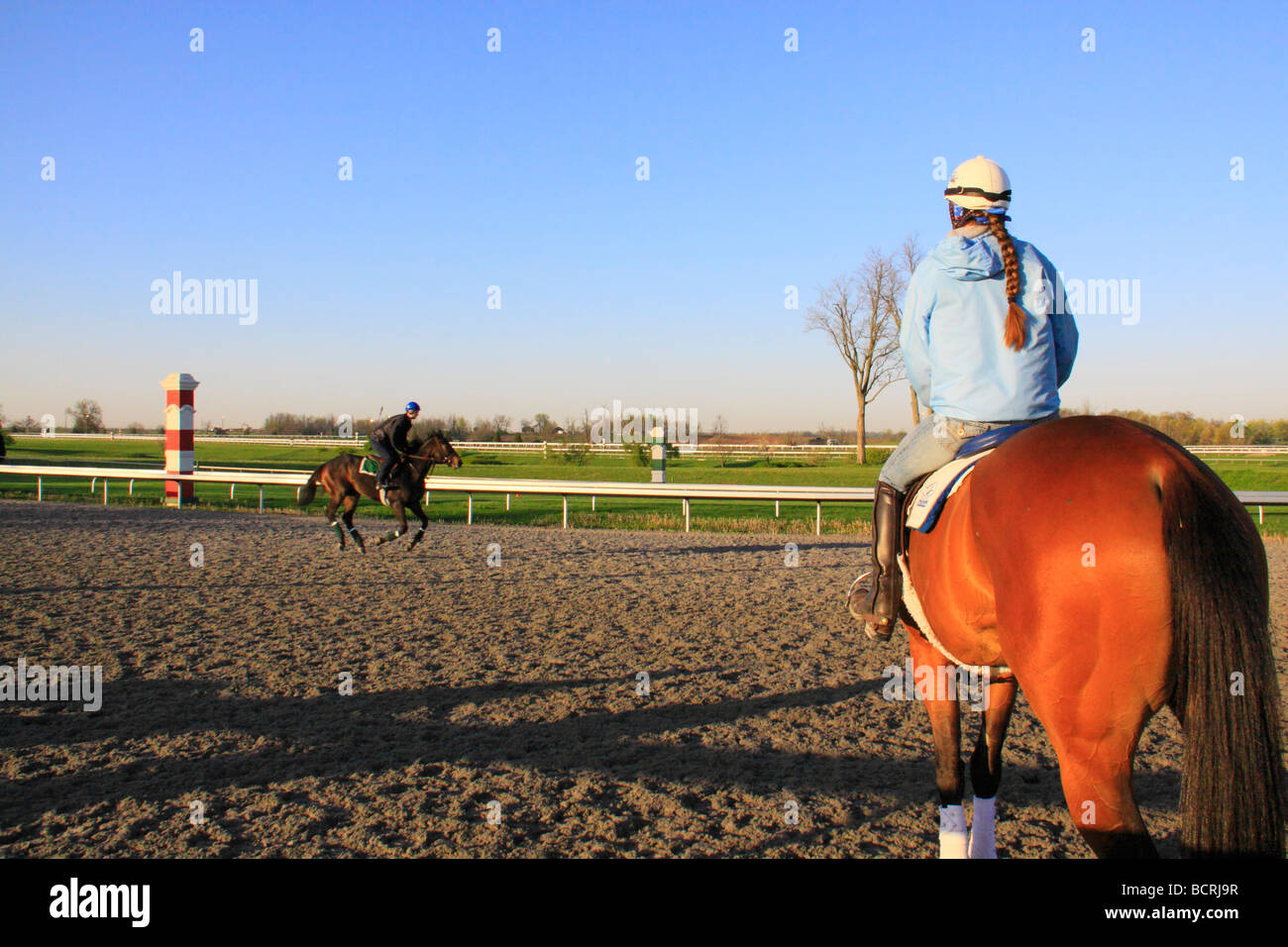 Exercise riders on thoroughbreds at early morning workout at Keeneland Race Course Lexington Kentucky - Stock Image