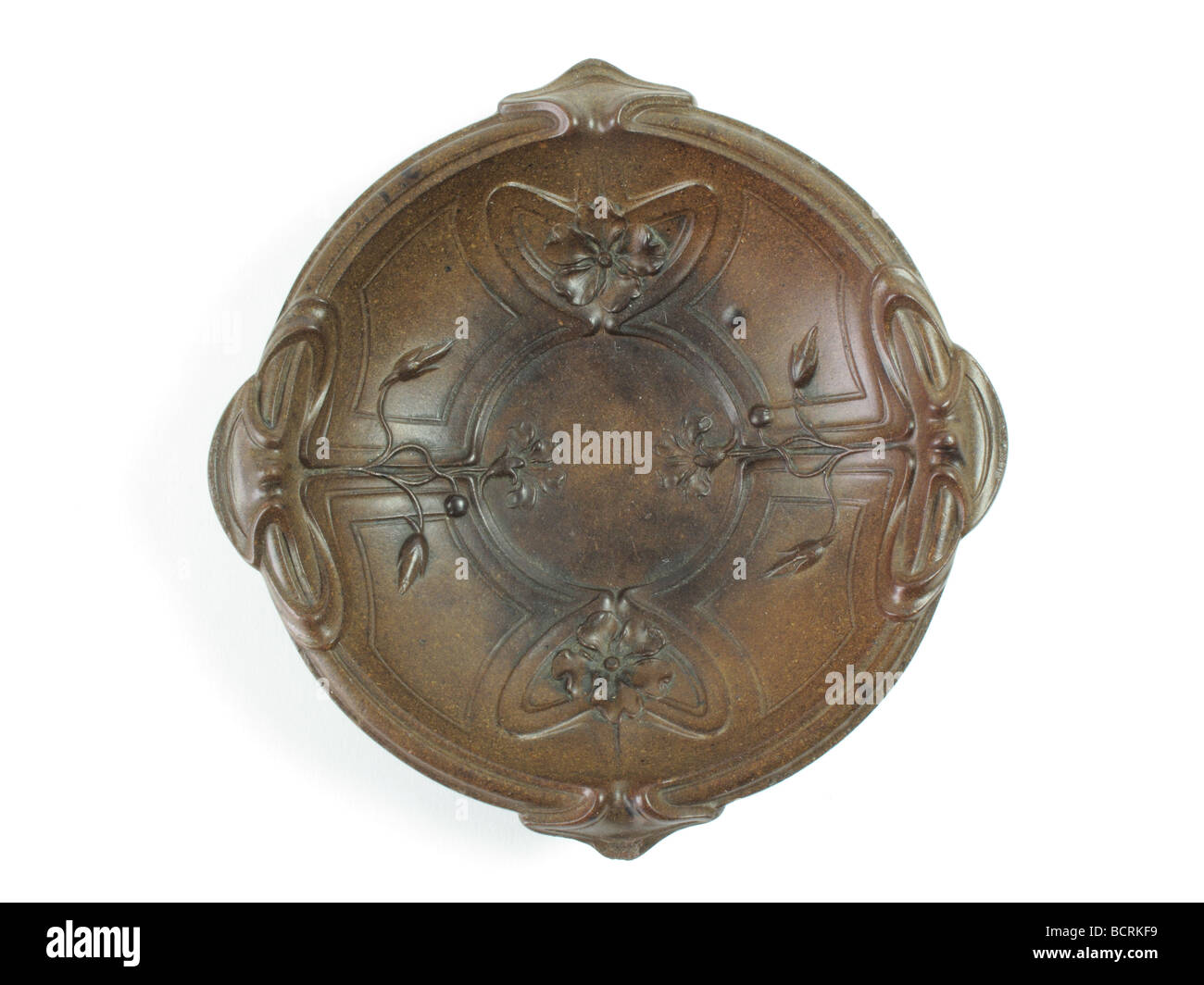 antique Bakelite dish with Art Nouveau relief decoration of flowers and whiplash lines, made circa 1910 - Stock Image