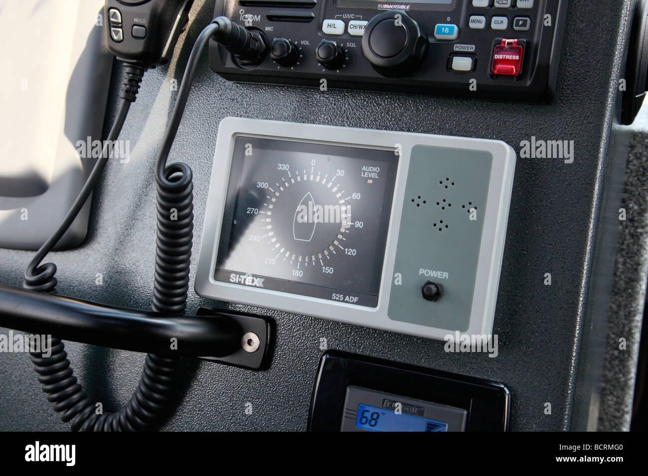 VHF radio, temperature control console on rescue vessel - Stock Image