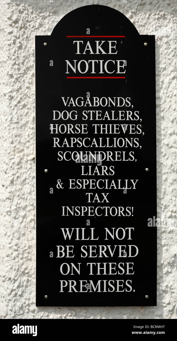 Amusing notice outside an English pub. - Stock Image