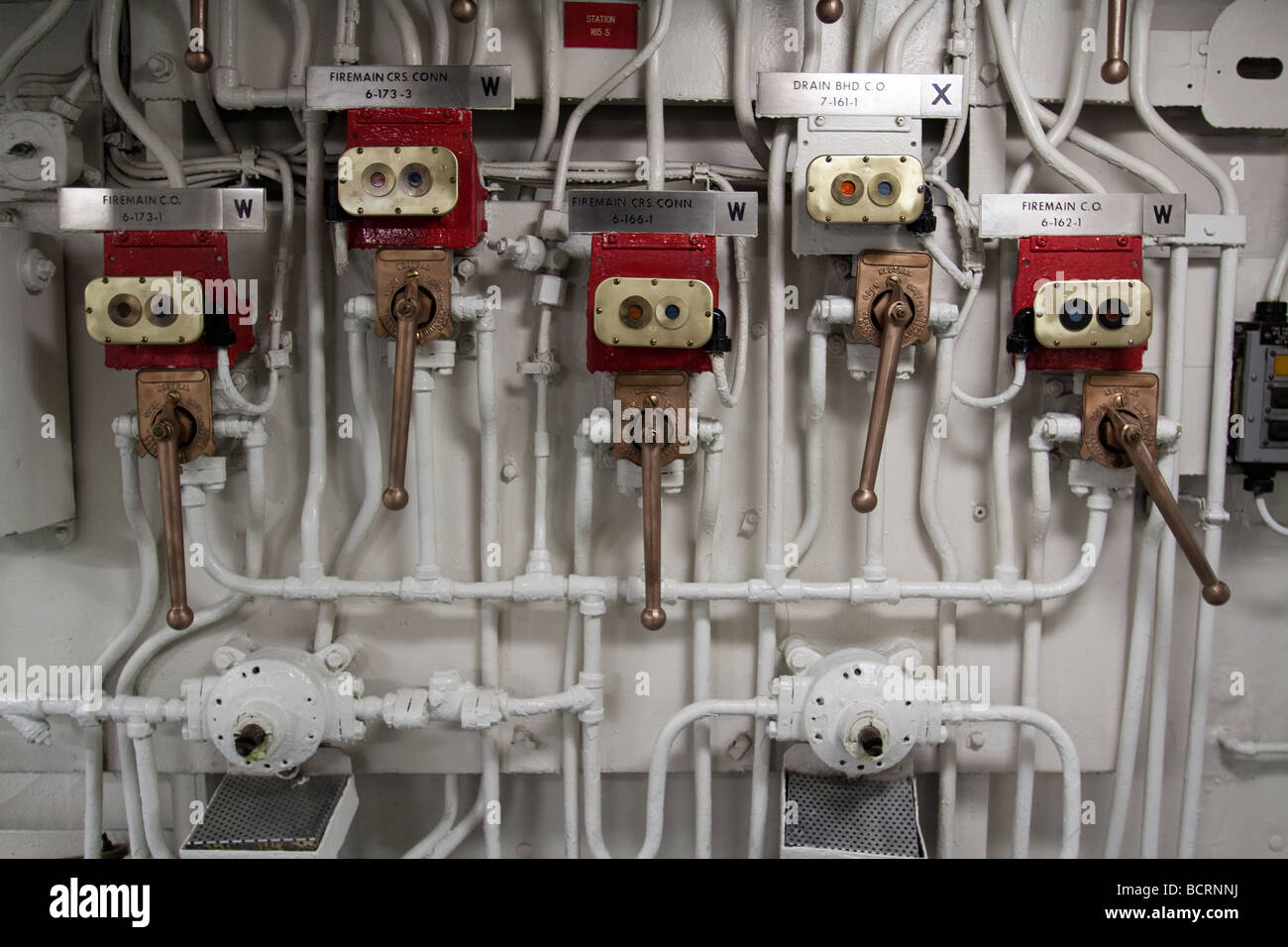 Many valves levers and pipes part of the infrastructure of the Midway aircraft carrier - Stock Image