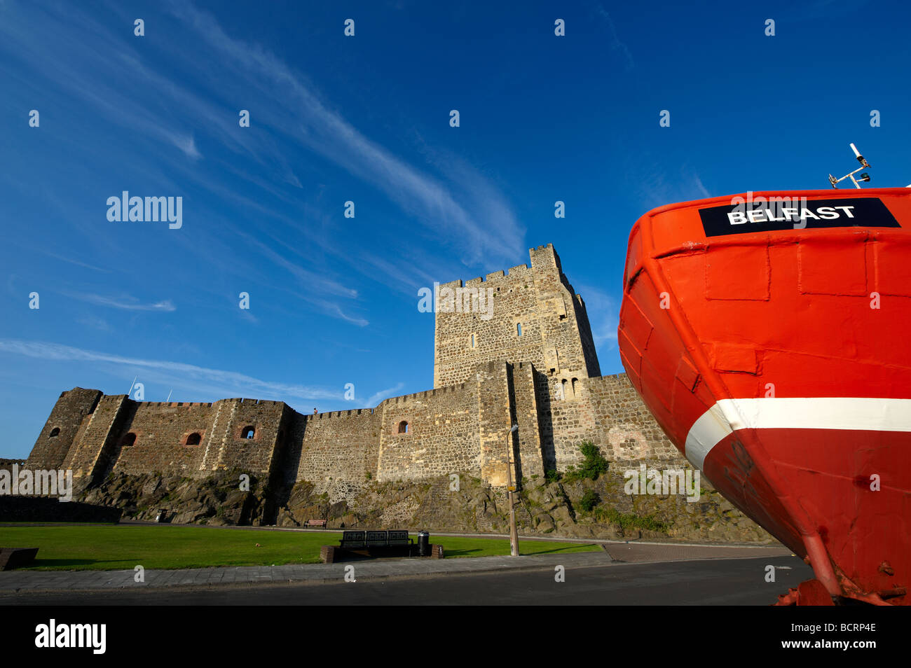 Carrickfergus Castle with the front of a fishing trawler in the foreground County Antrim - Stock Image