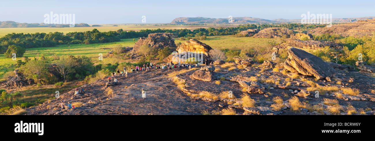 Tourists gather on Ubirr Rock to watch the sunset. Kakadu National Park - Stock Image