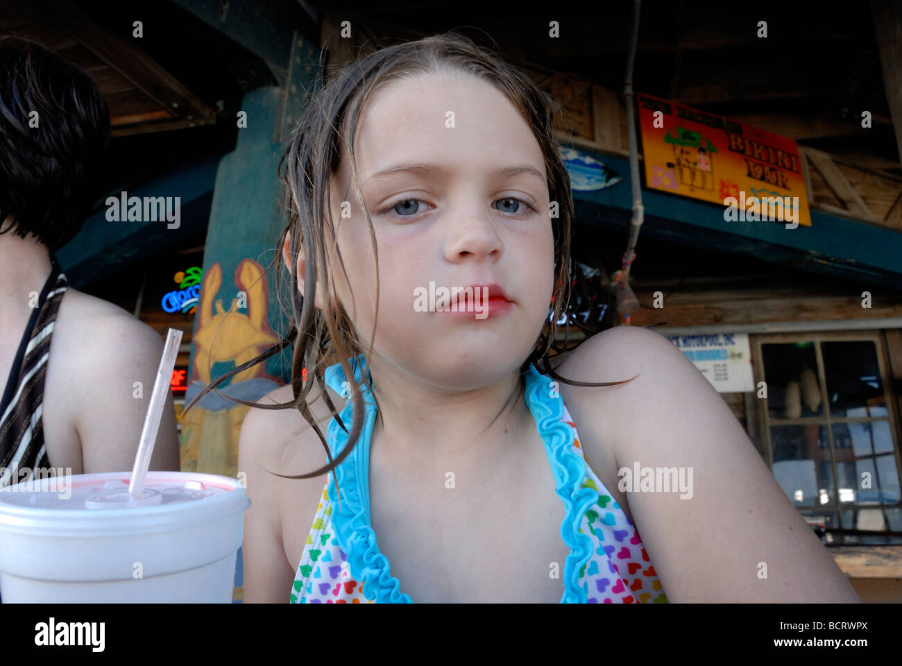 Young girl with skeptical look - Stock Image