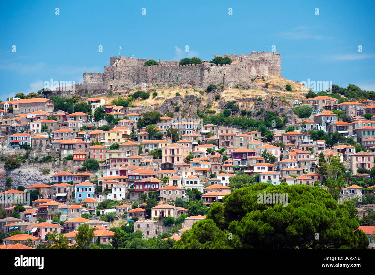 View of town of Molyvos or Mithymna with historic castle on hill on Lesvos Island in Greece - Stock Image