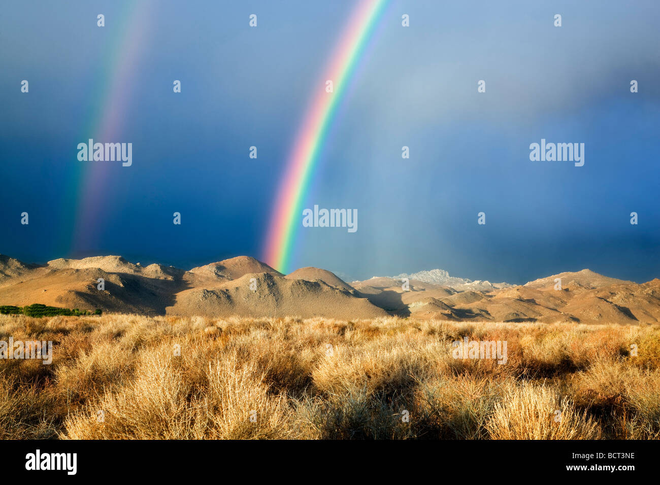 Double rainbow over Eastern Sierra Mountains near Bishop California - Stock Image