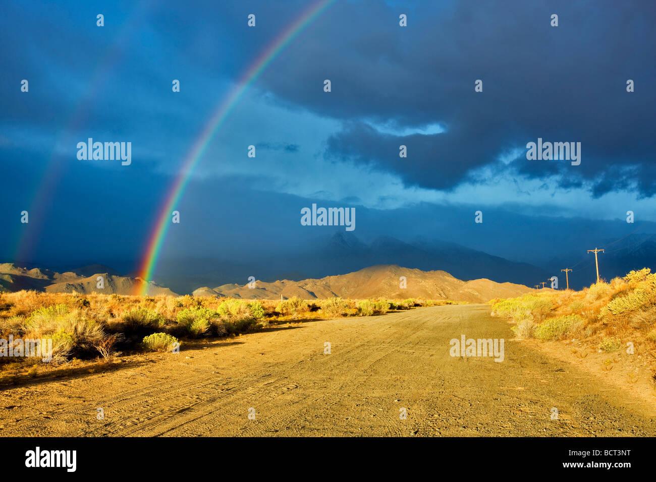 Rainbow over Eastern Sierra Mountains near Bishop California - Stock Image