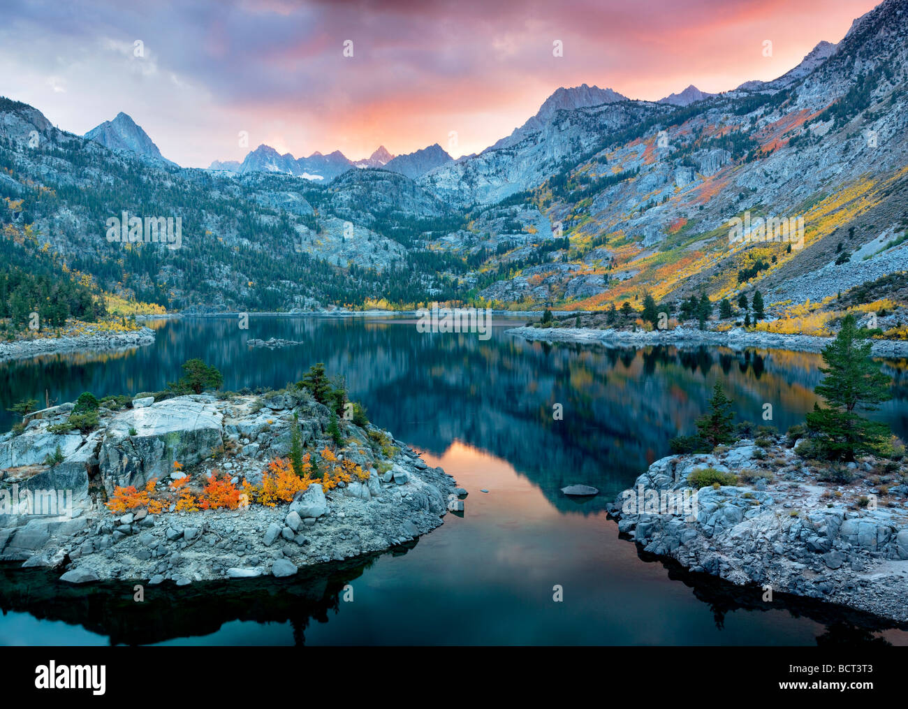 Lake Sabrina at sunset with fall colored aspens Inyo National Forest California Stock Photo