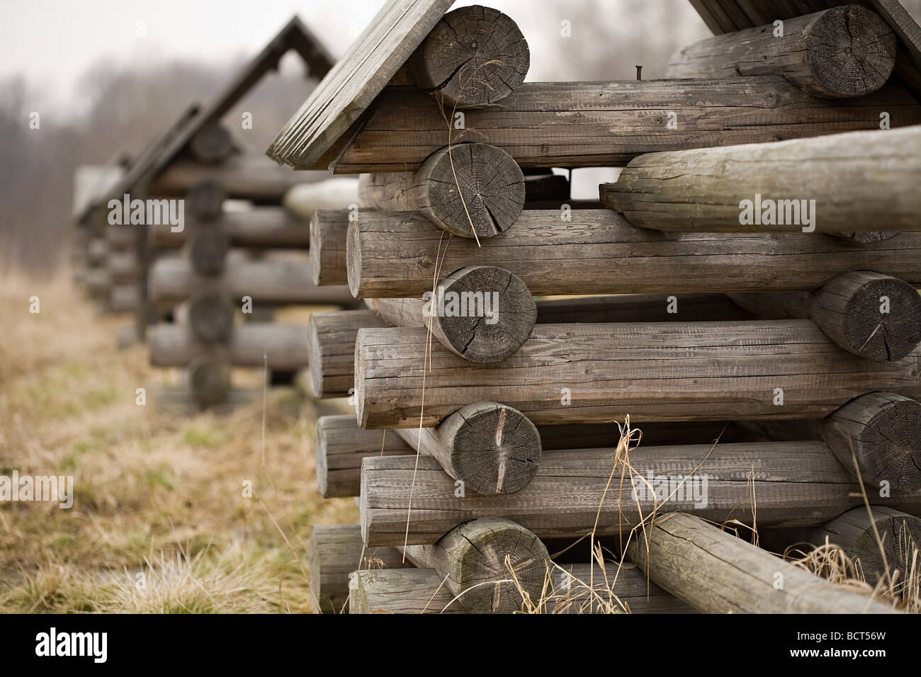 Old wooden beautiful izba in autumn - Stock Image