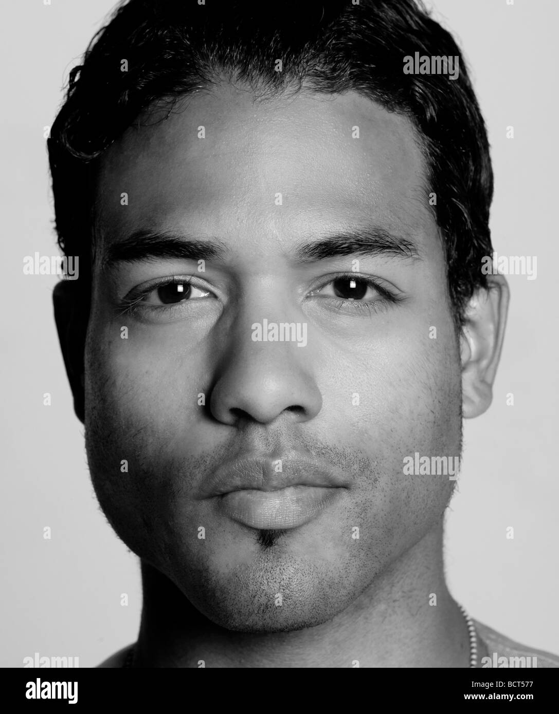 bi-racial male looking straight forward into the camera, twenties, 20's, 27, 28, 29, insightful, black and white - Stock Image