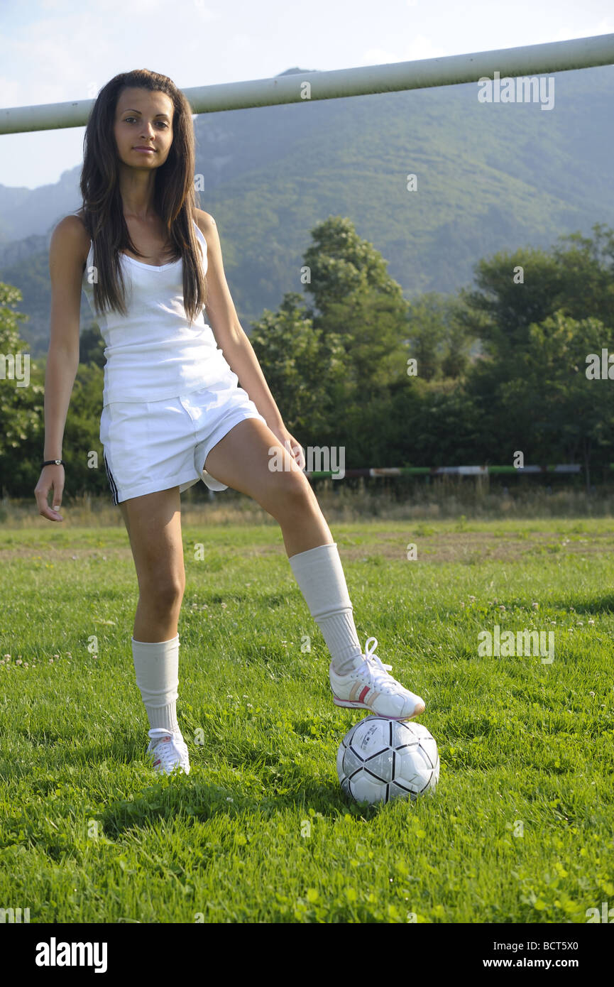 Young Sexy And Very Skinny Girl Playing With Soccer Ball On A Stadium