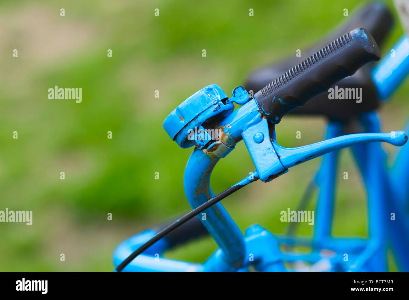 Handlebar of an old bicycle painted blue - Stock Image