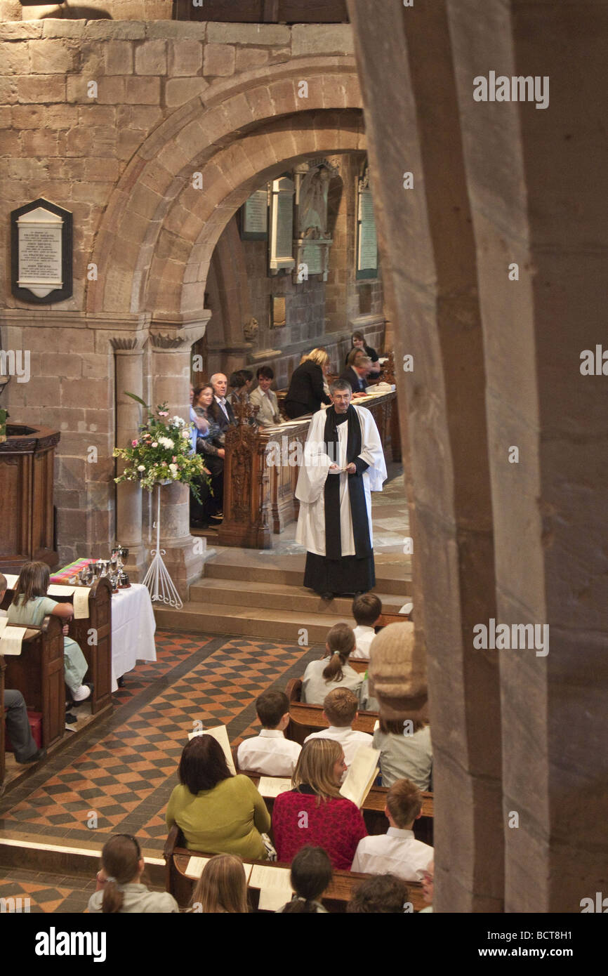 Rector conducting service at Berkswell church. - Stock Image