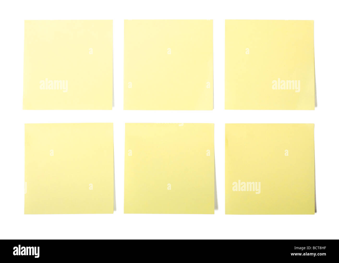Yellow post it note on white background - Stock Image