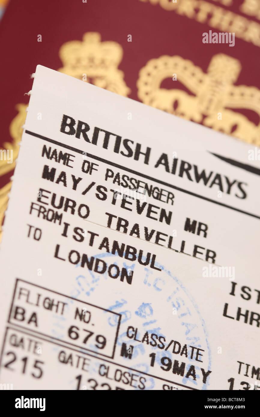 International travel concept passport and passenger flight boarding card airplane ticket - Stock Image