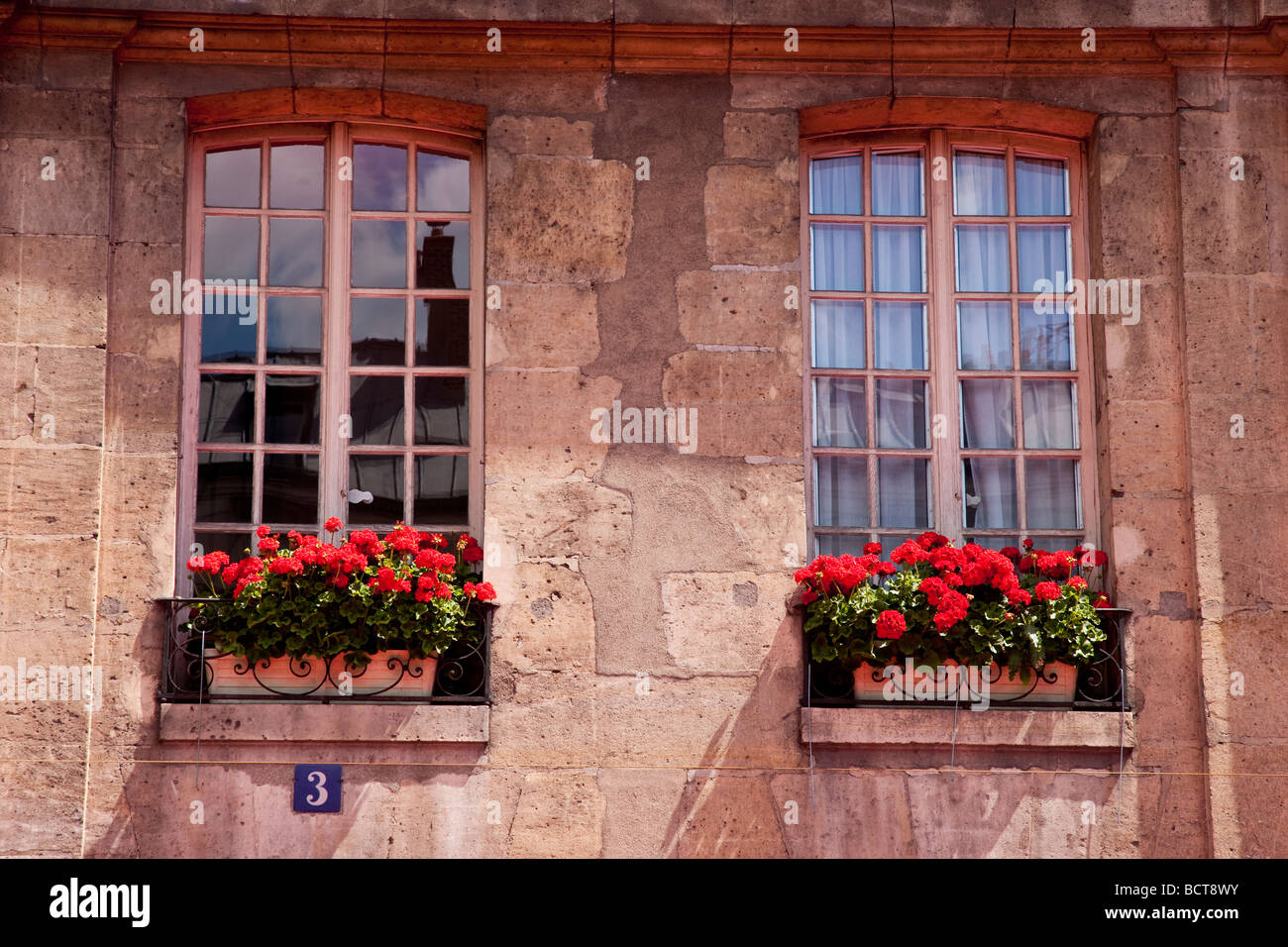 Windows and flower boxes in St. Germain, Paris France - Stock Image