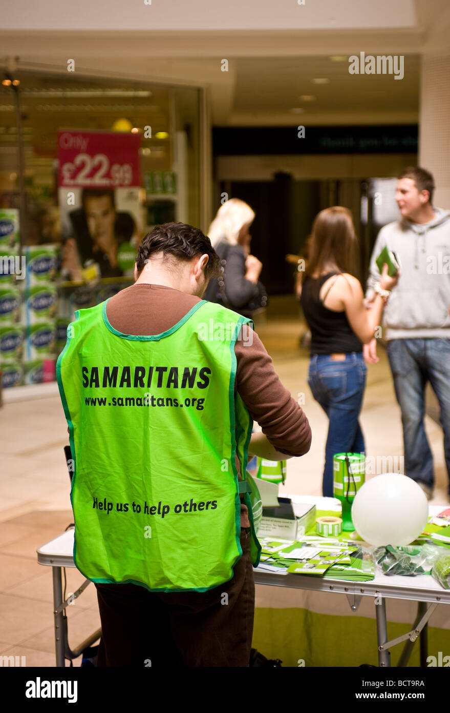 A volunteer from the charity The Samaritans fundraising. - Stock Image