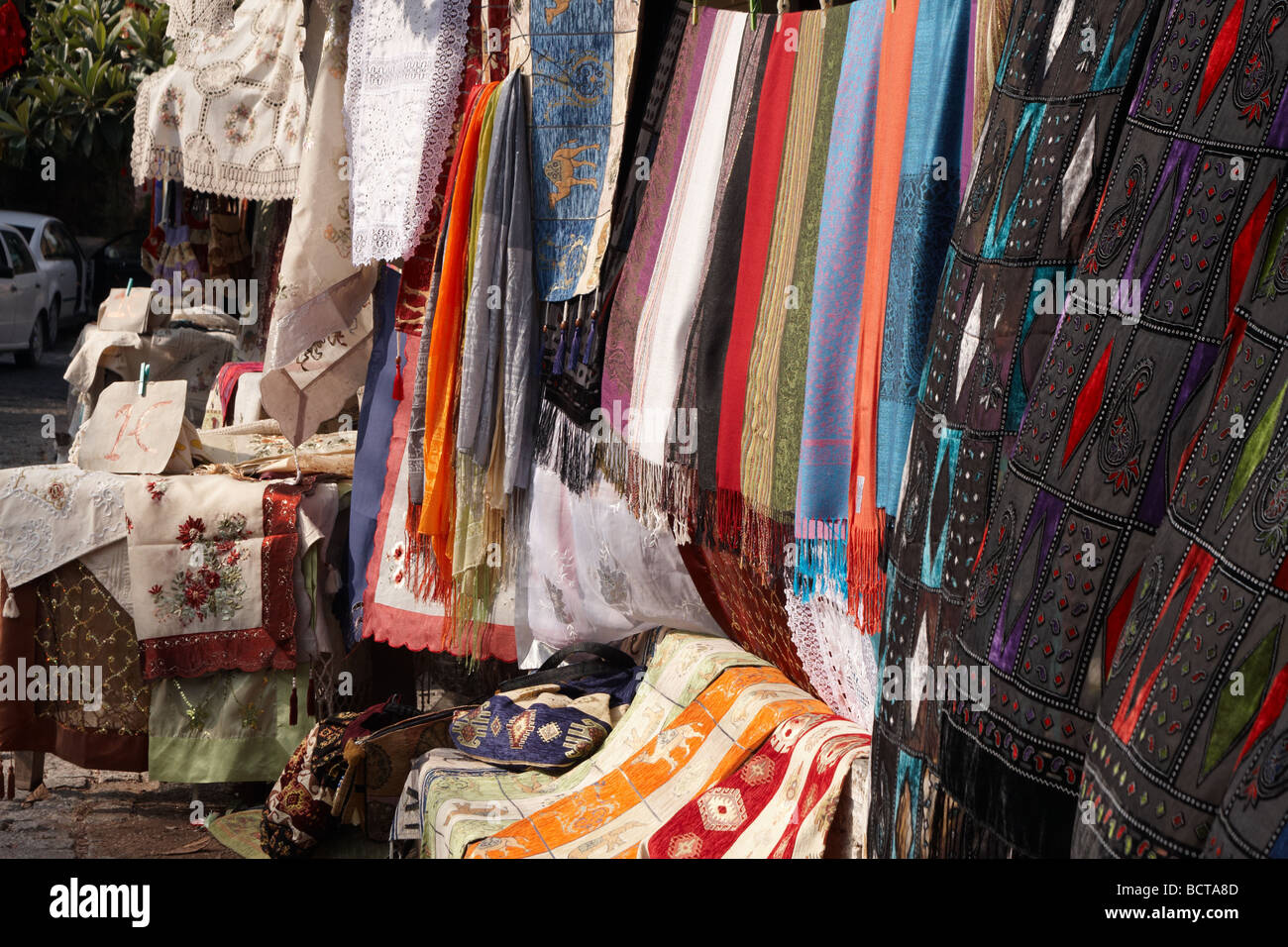 Richly coloured traditional fabric for sale at the market in a bazaar, Antalya Turkey - Stock Image