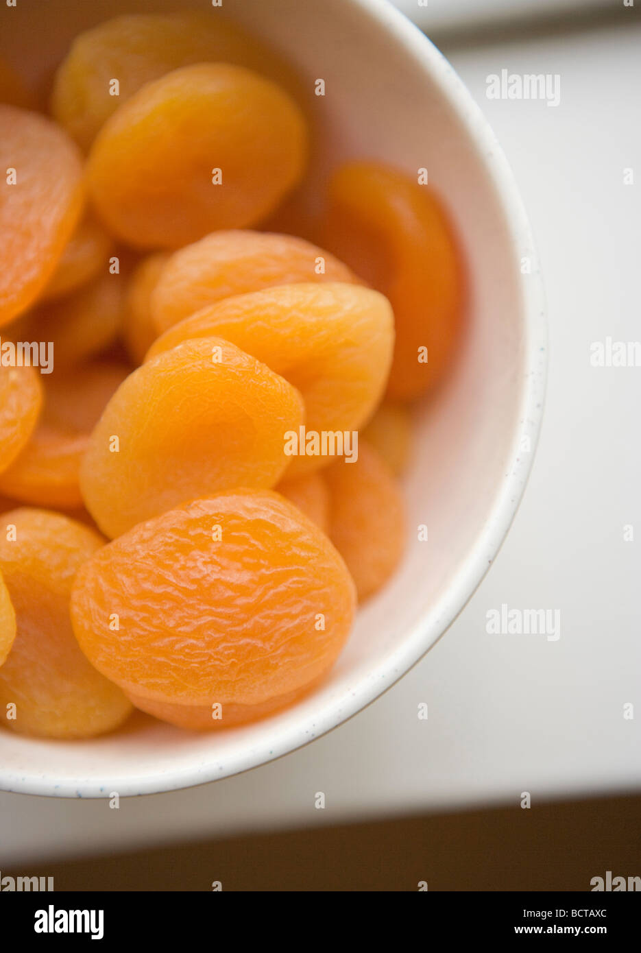 closeup of a bowl of dried apricots Stock Photo