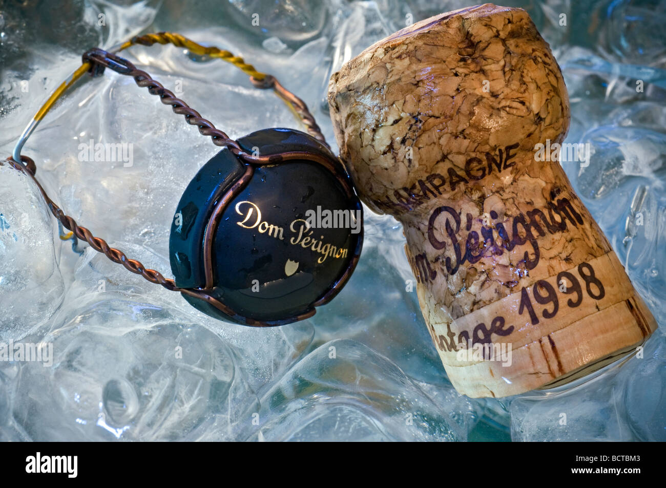 Dom Perignon wire retaining frame cap and vintage champagne cork in ice cooler - Stock Image