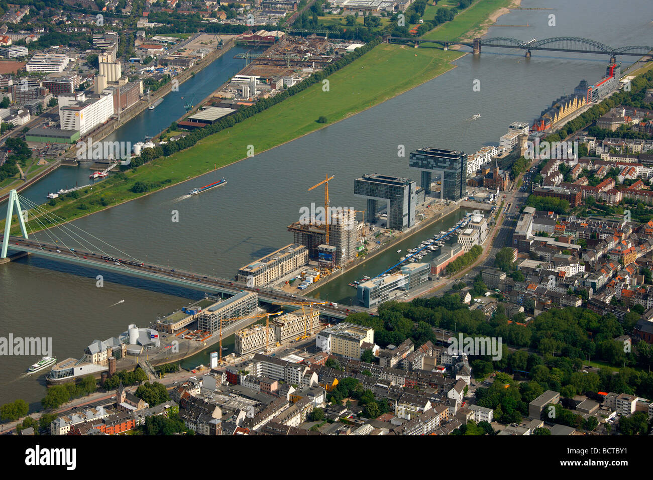 Aerial photograph, Kranhaus crane house construction site in Cologne Rheinauhafen, Pandion AG, Hafenquartier port - Stock Image