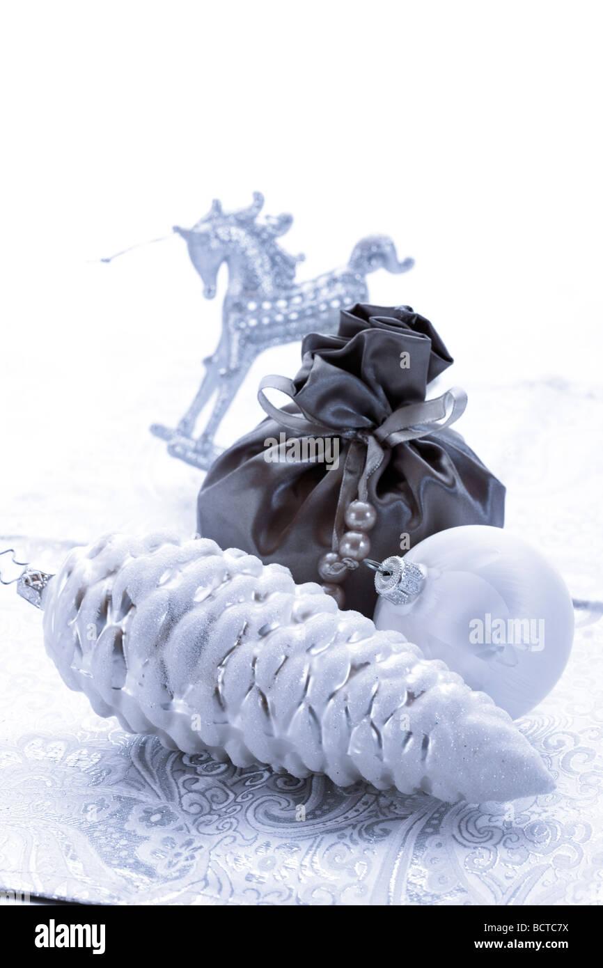 Silver Christmas decoration, fir cone, Christmas ball, gift bag and
