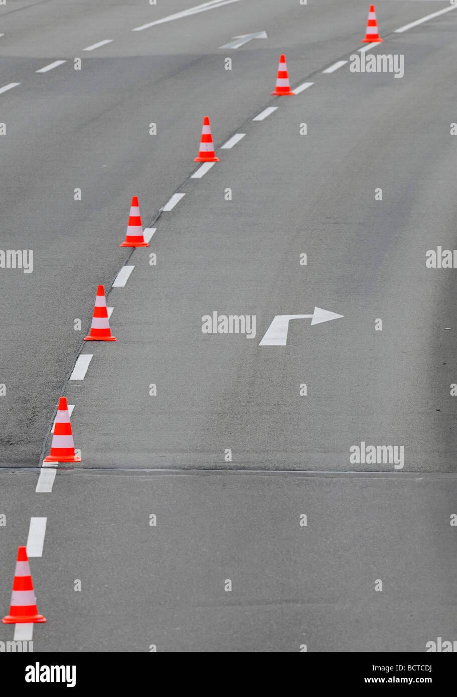 Traffic cones dividing a road lane - Stock Image