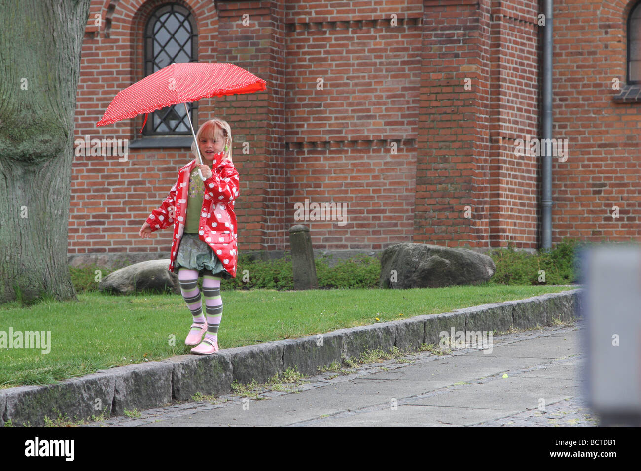Girl with umbrella in Hilleroed  north from  the city of copenhagen denmark - Stock Image