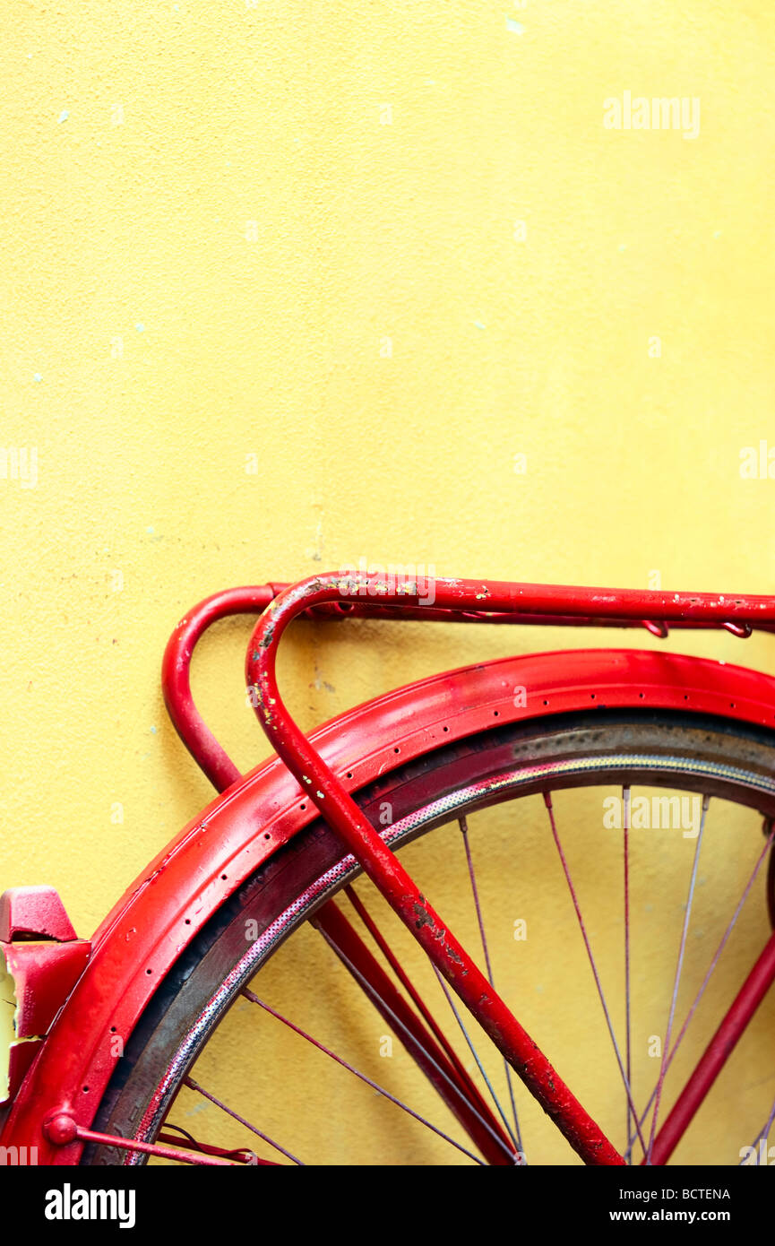 Rear wheel of an old bicycle painted red - Stock Image