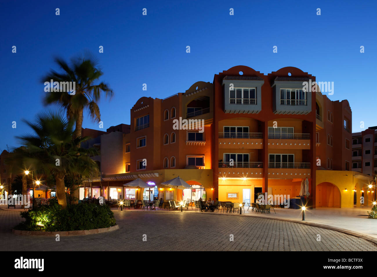 Houses with pubs, illuminated, evening, marina, Hurghada, Egypt, Red Sea, Africa - Stock Image