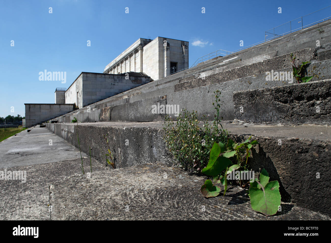 Plants growing on Adolf Hitler's tribune in front of the Zeppelinfeld field, Reichsparteitagsgelaende Nazi party - Stock Image