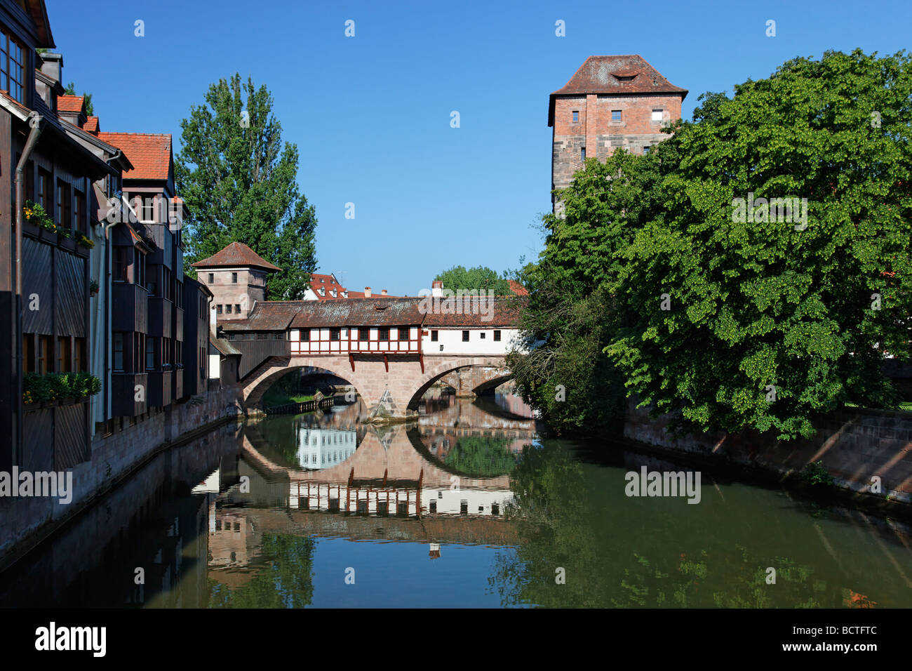 Executioner's home with half-timbered building, bridge building with two arches, small fortified tower and high - Stock Image
