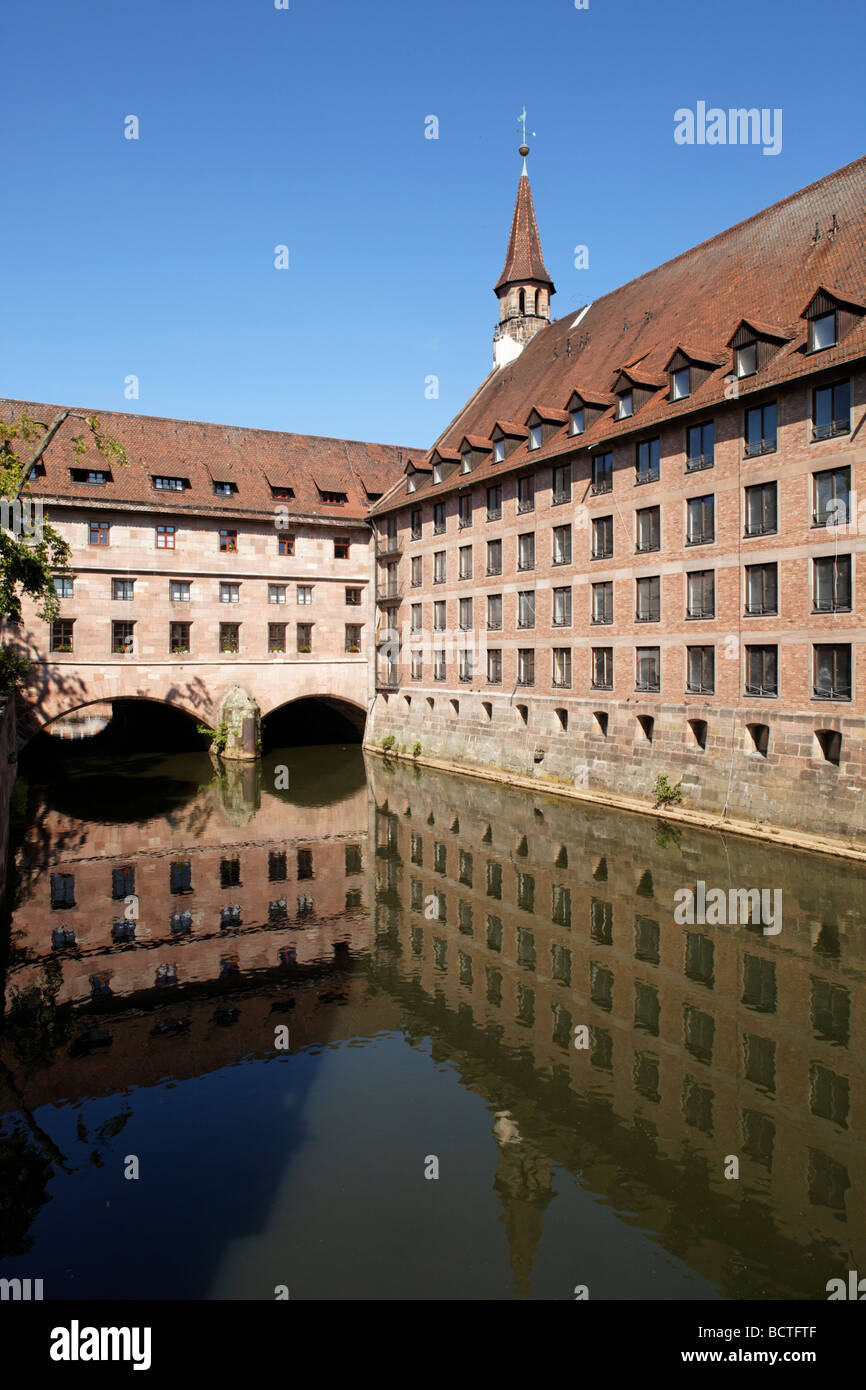 Public historic Heilig-Geist-Spital Holy Spirit hospital, retirement home, church tower, courtyard, arcades, reflection, Stock Photo
