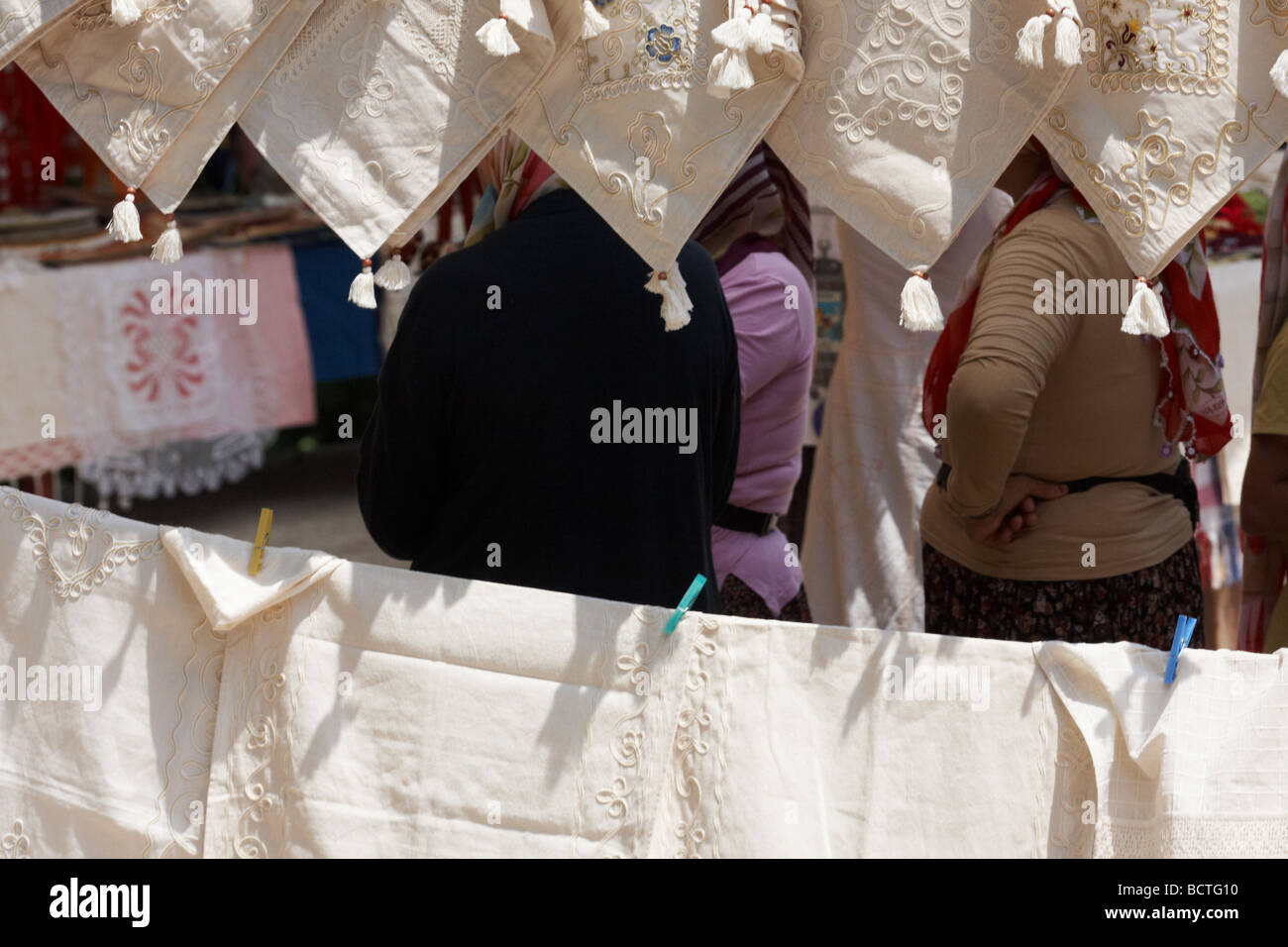Richly coloured traditional fabric for sale at the market in a bazaar, Alanya Turkey - Stock Image