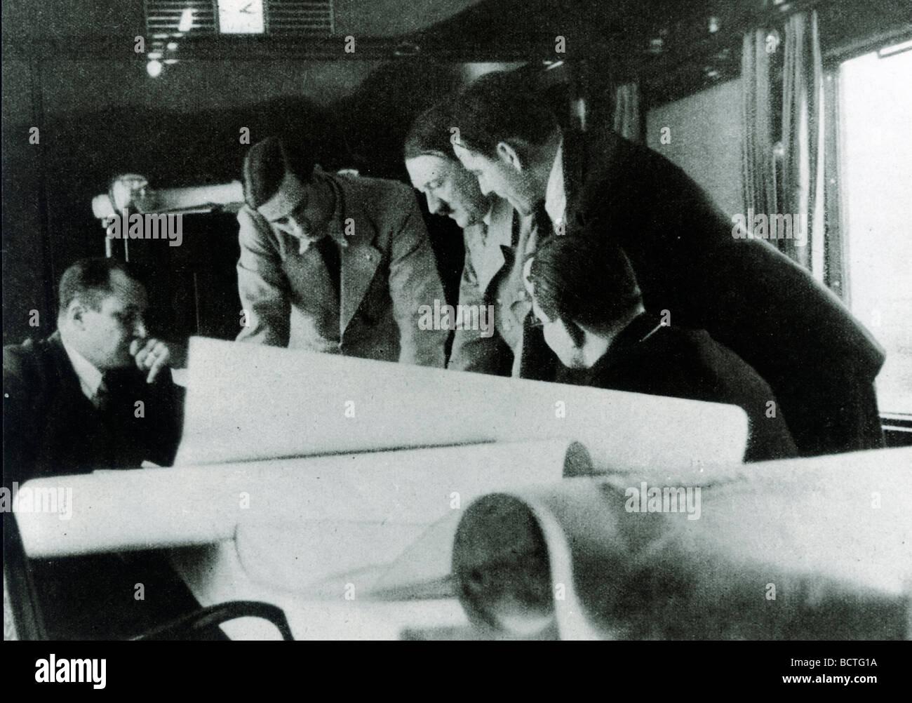 Reichsleiter Bouhler, Prof. Speer, Adolf Hitler, Dr. Brand, Reichsleiter Bormann during a meeting in the special - Stock Image