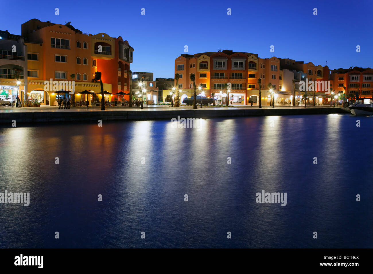 Illuminated houses with restaurants at marina, Hurghada, Egypt, Red Sea, Africa - Stock Image